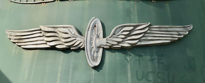 Emblem on front of a locomotive showing a winged wheel