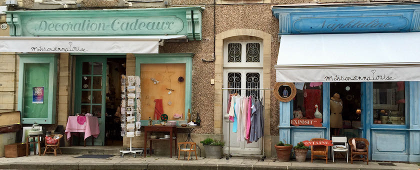 Storefront of traditional shops (seen in Bayeux, France)