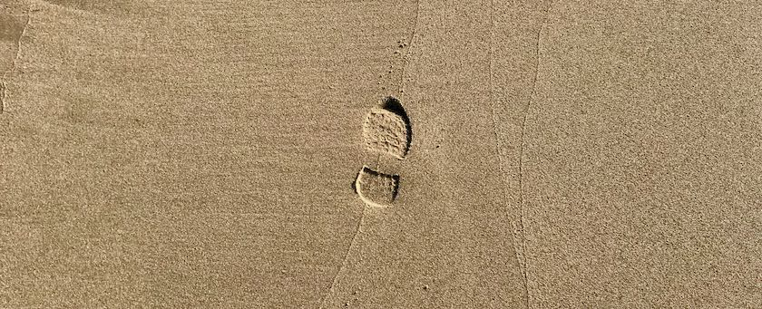 A single footstep in the sand