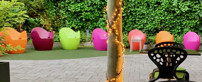 A few artful, yet simple outdoor chairs (seen in a hotel courtyard)